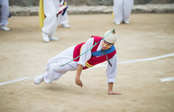 Korean Folk Dancers and Musicians. Seoul, South Korea - January 28, 2016: The ending of the traditional Korea farmers dance at the Korean folk village in Yongin royalty free stock photography