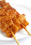 Korean fast food kebabs. A popular street snack foods in Korea - streaky pork meat sliced thinly, than marinated in a mixture of herbs and spices including Stock Photography