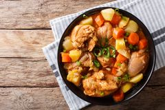 Korean food: Dakdoritang chicken stew with vegetables close-up o. N a plate on the table. horizontal top view from above Royalty Free Stock Images