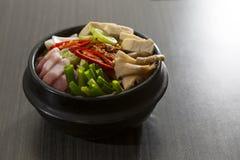 Korean Food. A heated stone bowl dish of korean food with pork and mushroom Stock Photo