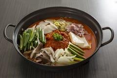 Korean Food. A heated stone wok of korean food with pork and mushroom Royalty Free Stock Photos