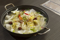 Korean Food. A heated wok of korean stew with boiled cartilage, cabbage, spring onion - Dogani Jeongol Stock Image