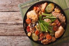 Korean food jjimdak: Stewed chicken with vegetables. Horizontal. Korean food jjimdak: Stewed chicken with vegetables on a plate. horizontal view from above Stock Images