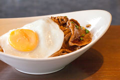 Korean food spicy barbecue beef with fried egg and rice Stock Image
