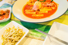 Tukbokki with Boiled egg topping and Kimchi. Royalty Free Stock Images