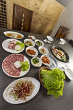Korean Food. A vertical dynamic shot of korean casseroles with side dishes Royalty Free Stock Photos