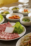 Korean Food. A vertical shot of beef with korean side dishes Stock Photography