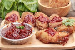Korean fried chicken is delicious on wood background. Royalty Free Stock Photos