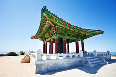 Korean Friendship Bell housed in grand belfry. Close-up picture of Korean Friendship Bell housed in belfry with hipped roof in Angel`s Gate Park, California, USA Royalty Free Stock Images