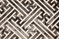 Korean Geometric Pattern In Wood. A geometric pattern made of wood slats is one of the architectural details in one of the buildings in the Gyeongbokgung Palace Royalty Free Stock Images