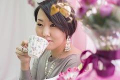 Korean the girl is drinking tea Royalty Free Stock Image