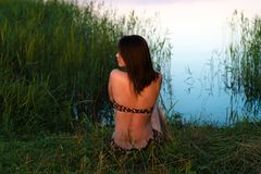 Korean girl sitting on pond in evening stock photos