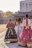 Korean girls in colurful national traditional costumes hanbok walking in a gyeongbokgung palace in Seoul South Korea