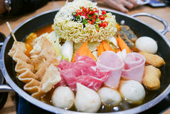 Korean Hot pot `Budae Jjigae` or Army Stew, a Korean fusion foo. Korean Hot pot `Budae Jjigae` or Army Stew is Korean fusion food incorporates American style stock photography