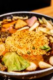 Korean Hot pot 'Budae Jjigae' is Korean fusion food incorporates American style with noodle, ham, sausages, and Kimchi. Korean Hot pot 'Budae Jjigae' is Korean royalty free stock photo