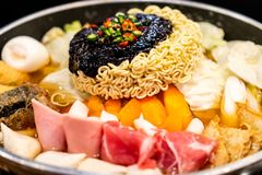 Korean Hot pot \'Budae Jjigae\' is Korean fusion food incorporates American style with noodle, ham, sausages, and Kimchi. Korean Hot pot \'Budae Jjigae\' is royalty free stock images