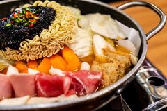 Korean Hot pot \'Budae Jjigae\' is Korean fusion food incorporates American style with noodle, ham, sausages, and Kimchi. Korean Hot pot \'Budae Jjigae\' is stock image