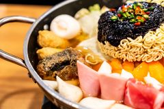 Korean Hot pot \'Budae Jjigae\' is Korean fusion food incorporates American style with noodle, ham, sausages, and Kimchi. Korean Hot pot \'Budae Jjigae\' is stock photography