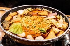 Korean Hot pot \'Budae Jjigae\' is Korean fusion food incorporates American style with noodle, ham, sausages, and Kimchi. Korean Hot pot \'Budae Jjigae\' is stock photos
