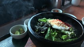 Korean hot stone cooking. At a restaurant in Kobe city, Japan stock video