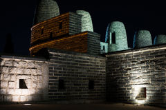 Korean hwaseong fort smoke signal stack at night. Ancient historic fort in South Korea asia illuminated at night. Stone brick unusual unique smoke signal towers Royalty Free Stock Images