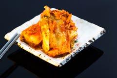 Korean kimchi. Spicy korean kimchi with chopstick Stock Image