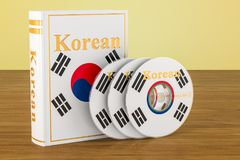Korean language textbook with flag of South Korea and CD discs o. N the wooden table. 3D Stock Photo