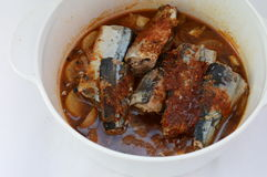 Korean mackerel stew. Korean spicy mackerel stew in a white pot Stock Photo