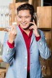 Korean man choosing household items Royalty Free Stock Photo