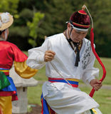 Korean Man in Headdress Dancing at Cultural Celebration Royalty Free Stock Image