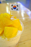Korean Mango Bingsu Milk Ice Cream. Mango bingsu on table, Korean dessert Stock Image
