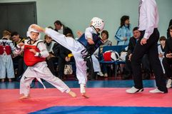 Taekwondo competitions between children. The Korean martial art of taekwondo. 17.03.2013, city of Orenburg, Southern Ural, Russia Royalty Free Stock Photo