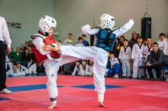 Taekwondo competitions between children Stock Images