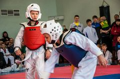 Taekwondo competitions between children. The Korean martial art of taekwondo. 17.03.2013, city of Orenburg, Southern Ural, Russia Royalty Free Stock Photography