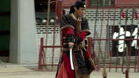 Korean martial arts. Warriors Hvarang. Cutting sword straw sheaves. stock footage