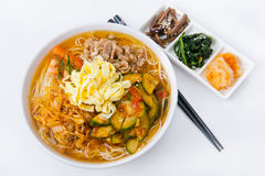 Korean meal. With fern, spinach and daikon, and soup with noodles, meet and vegetables stock photos