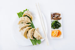 Korean meal. With meet dumpling and spicy vegetables stock photos