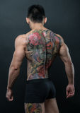 Korean model with tattoo. Male model with a snake and skull tattoo Royalty Free Stock Photos