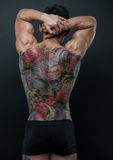 Korean model with tattoo. Male model with a snake and skull tattoo Royalty Free Stock Images