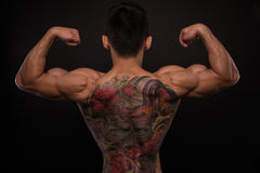 Korean model with tattoo. Male model with a snake and skull tattoo stock photo
