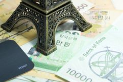 Korean money - money, finances and travel concept with Eiffel to. Wer replica : finance and economy concept Royalty Free Stock Photos