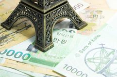 Korean money - money, finances and travel concept with Eiffel to. Wer replica : finance and economy concept Stock Photography