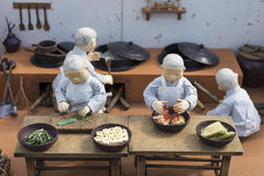 Korean monk figures preparing traditional food Stock Photo