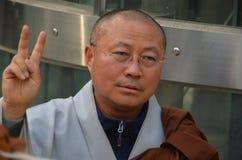 Korean monk make sign of peace Stock Photos