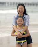 Korean mother and Amerasian daughter by the ocean Royalty Free Stock Image