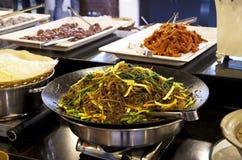Korean noodle in restaurant buffet. Yummy stirred fried Korean noodles in a buffet restaurant Stock Photo