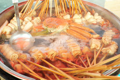Korean odeng guk skewered fish cake in seafood and vegetable broth. Odeng guk or eomuk guk is a popular snack in South Korea made with fish cake skewered in a royalty free stock photo