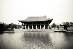 Korean palace pavilion surrounded by a lake Stock Images