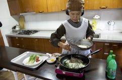 Korean pancake making lesson Royalty Free Stock Photo