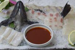 Korean raw fish (sashimi with hot pepper sauce). Fresh Korean Raw Fish  (Sashimi) with spicy chili sauce Royalty Free Stock Photo